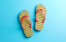Flip flops on color background, space for text. Summer vacation stock photo