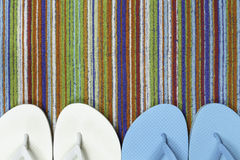 Flip Flops and Colorful Beach Towel Stock Photos