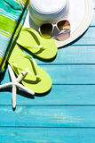 Flip flops. Colorful flip flops by a swimming pool stock photo