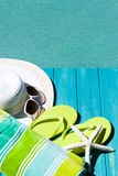 Flip flops. Colorful flip flops by a swimming pool stock images
