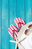 Flip flops. Colorful flip flops by a swimming pool royalty free stock photography