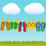 Flip-flops coloridos Imagens de Stock