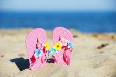 Flip flops. Cute flip-flop at the sandy beach stock image