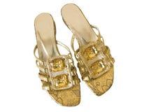 Flip-flops dourados isolados no branco Foto de Stock