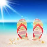 Flip-flops e escudos na praia ilustração stock