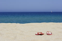 Flip flops on empty sandy beac. H, corsica, mediterranean stock photos