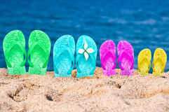 Flip flops of a family of four in the sand Royalty Free Stock Images