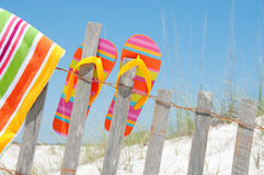 Flip flops on fence Stock Images