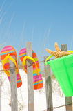 Flip flops on fence Royalty Free Stock Photos