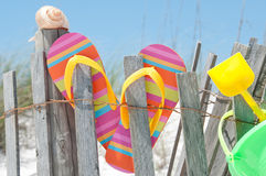 Flip flops on fence. Flip flops hanging on fence Royalty Free Stock Photo