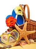 Flip-flops, fishstar, wicker basket. Stock Photos