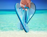 Flip flops. On a beach stock images