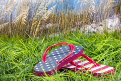 Flip flops in grass at beach Royalty Free Stock Images