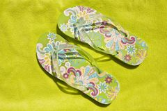 Flip-flops on a green towel Royalty Free Stock Photos