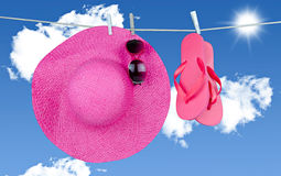 Flip- flops hang on a washing line Royalty Free Stock Photo