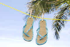 Flip flops hanging on clothesline Royalty Free Stock Images