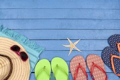 Free Flip-flops, Hat, Beach Towel And Sunglasses On Wooden Table. Stock Photo - 169183500