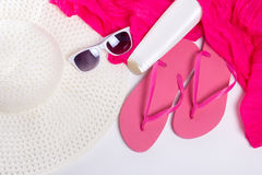 Flip flops, hat, sunglasses over white Stock Photos