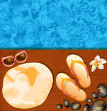 Flip-flops, hat, sunglasses and stones Royalty Free Stock Images