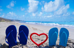 Flip flops with heart on the beach Royalty Free Stock Photography