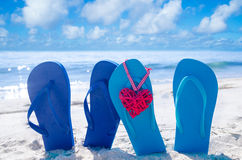 Flip flops with heart on the beach royalty free stock image