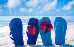 Flip flops with hearts on the beach Royalty Free Stock Image