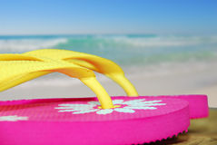 Flip flops by Ocean Royalty Free Stock Photos
