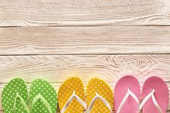 Flip-flops over wooden background Royalty Free Stock Images