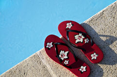 Flip-flops by the pool Royalty Free Stock Image