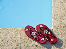 Flip-flops by the pool Stock Image
