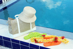 Flip flops and pool accessories Stock Photography