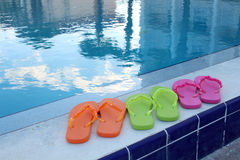 Flip flops and pool accessories Stock Photo