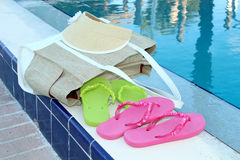 Flip flops and pool accessories Stock Photos