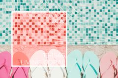 Flip flops near a pool. Living coral theme - color of the year 2019. Flip flops at the pool border Horizontal. Living coral theme - color of the year 2019 royalty free stock photos