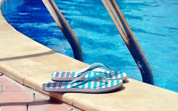 Flip flops at pool Stock Photography