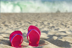 Flip flops by raging surf Stock Images