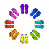 Flip Flops. Rainbow flip flops in the circle. Isolated on the white Stock Photos