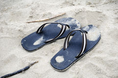 Flip flops in sand Stock Photos