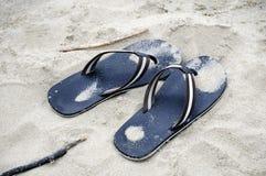 Flip flops in sand Stock Photos