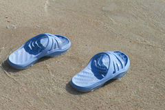 Flip-flops on the sand Stock Photos