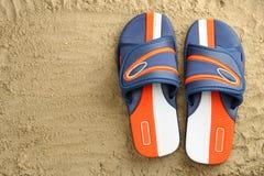 Flip flops on sand Stock Photography