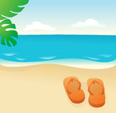 Flip Flops On The Sand Stock Photo