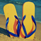 Flip-flops on the sand of a beach Stock Image