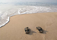 Flip flops in the sand on beach Royalty Free Stock Images