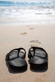 Flip flops on a sand beach Royalty Free Stock Photo
