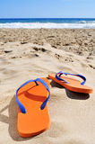Flip-flops on the sand of a beach Stock Images