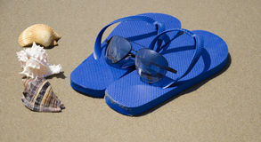 Flip flops on a sand Royalty Free Stock Photography