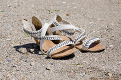 Flip-flops on the sand Stock Image