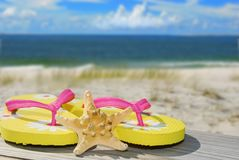 Flip flops and Sand dunes at beach Stock Photos
