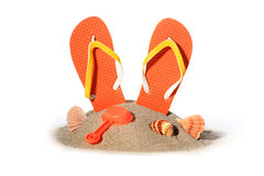 Flip-flops. Flip-flops in sand isolated over white background royalty free stock photos